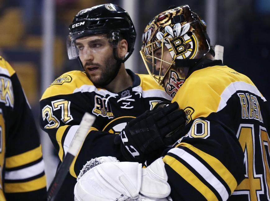 Boston Bruins center Patrice Bergeron (left).